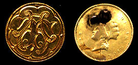 """AT or TA"" Gold Love Token on rare type II Gold dollar."